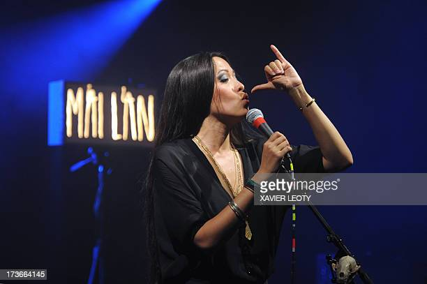 French singer Mai Lan performs on stage on July 16 2013 during the Francofolies music festival in La Rochelle western France AFP PHOTO / XAVIER LEOTY
