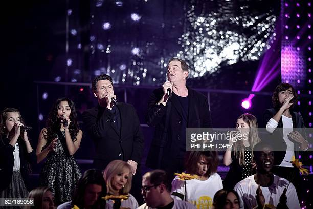 French singer Marc Lavoine and French Canadian singer Garou perform on stage during the launch of the 2016 French Telethon fundraising television...