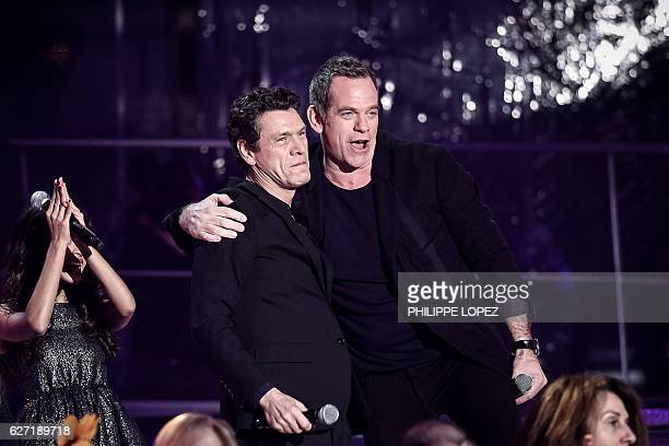 French singer Marc Lavoine and French Canadian singer Garou react after performing on stage during the launch of the 2016 French Telethon fundraising...