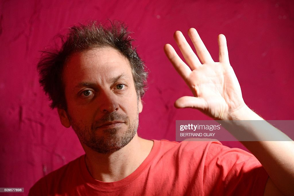 French singer Mathieu Boogaerts poses on February 11, 2016, in Paris. Mathieu Boogaerts will play at the Philharmonie de Paris for his 20 years of career on February 16 and 17, 2016. / AFP / BERTRAND GUAY