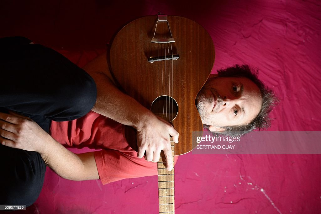 French singer Mathieu Boogaerts poses on February 11, 2016, in Paris. Mathieu Boogaerts will play at the Philarmonie de Paris for his 20 years of career on February 16 and 17, 2016. / AFP / BERTRAND GUAY