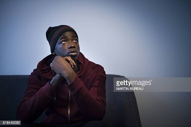 French singer MHD poses on March 31 2016 in Paris / AFP / MARTIN BUREAU