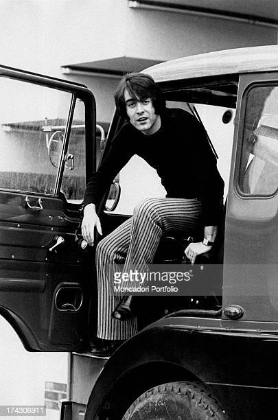 French singer Michel Delpech sitting on the front seat of a truck Milan 1970