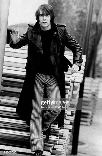 French singer Michel Delpech walking Milan 1970