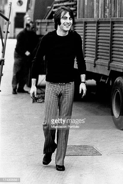 French singer Michel Delpech walking smiling Milan 1970