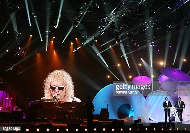 French singer Michel Polnareff appears on screen performing from Palais Omnisports de Paris Bercy during the 22nd 'Victoires de la Musique' ceremony...