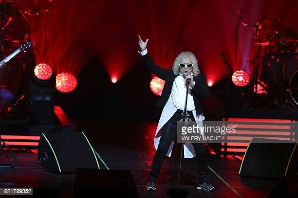 French singer Michel Polnareff performs on stage on November 8 2016 in Nice southeastern France / AFP / VALERY HACHE