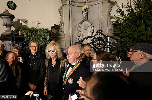 French singer Michel Polnareff stands in front of the small bronze sculpture of Manneken Pis dressed like the French singer on November 17 2016 in...