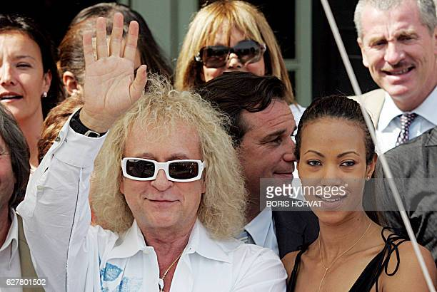 French singer Michel Polnareff waves to the crowd next to his wife 03 July 2007 in Marseille during the celebration of his 63rd birthday AFPPHOTO...