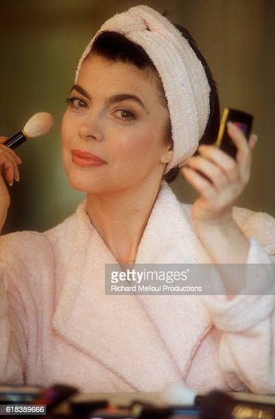 French Singer Mireille Mathieu Applying Cosmetics