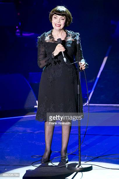 French singer Mireille Mathieu performs live during a concert at the Friedrichstadtpalast on March 2 2015 in Berlin Germany