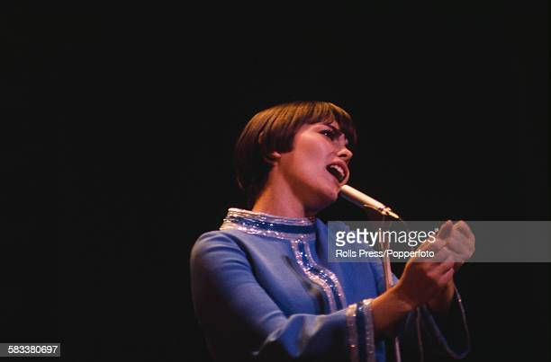 French singer Mireille Mathieu rehearses on stage before her appearance on the Royal Variety Show at the London Palladium in December 1967