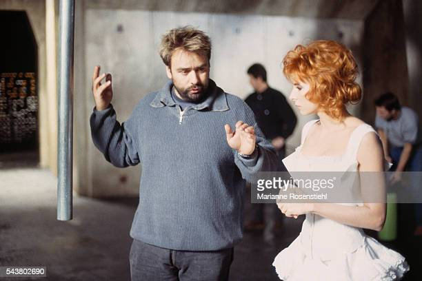 French singer Mylène Farmer on the set of her music video Que mon coeur lache directed by French producer and director Luc Besson
