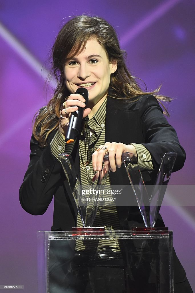 French singer of the band 'Christine and the Queens' Heloise Letissier smiles as she received the best newcomer live show award and the best video clip award during the 31st Victoires de la Musique, the annual French music awards ceremony, on February 12, 2016 at the Zenith concert hall in Paris. AFP PHOTO / BERTRAND GUAY / AFP / BERTRAND GUAY
