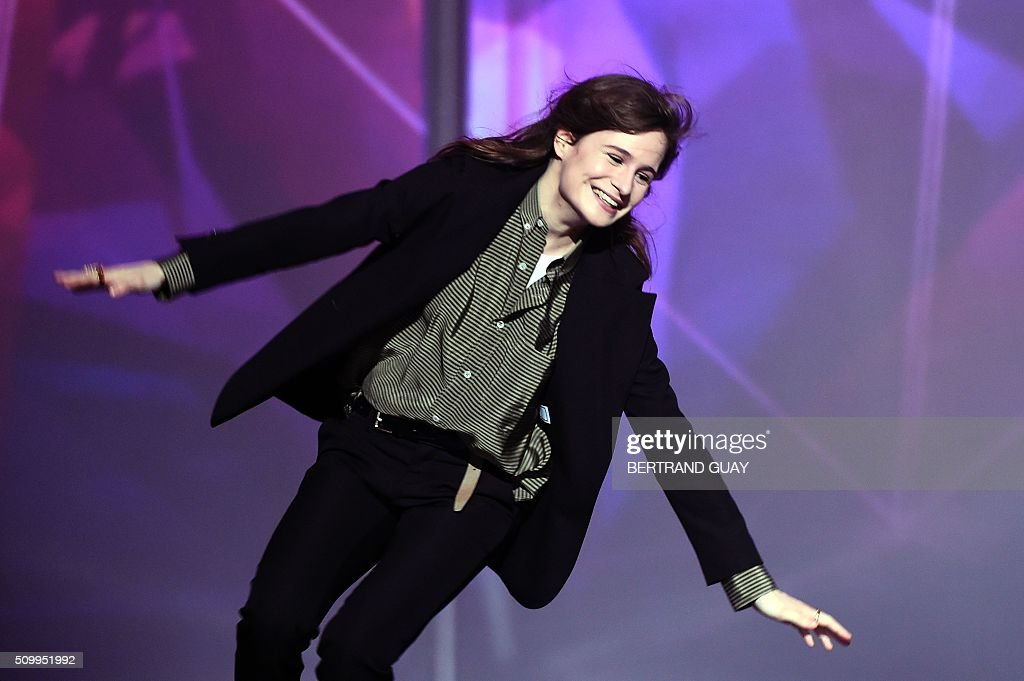 French singer of the band 'Christine and the Queens' Heloise Letissier gestures as she received the best live show award and the best video clip award during the 31st Victoires de la Musique, the annual French music awards ceremony, on February 12, 2016 at the Zenith concert hall in Paris. / AFP / BERTRAND GUAY