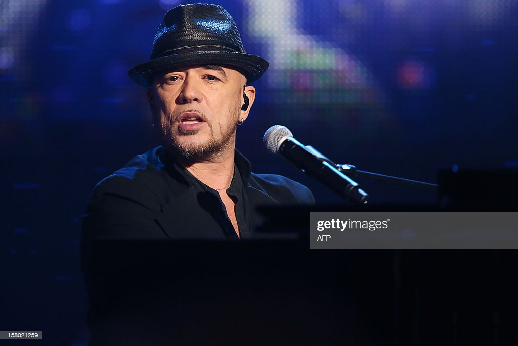 French singer Pascal Obispo sings during the 26th Telethon, France's biggest annual fund-raising event during 30 hours of live television transmission, on December 8, 2012 in Saint-Denis, north of Paris. The event aims at collecting funds for research on genetic diseases such as myopathy, a neuromuscular disease.