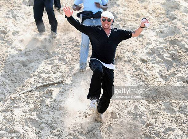 French Singer Pascal Obispo slides down Dune du pilat after the gathering for the planet organised by Gulli TV on Dune du Pilat at Le Pilat on April...