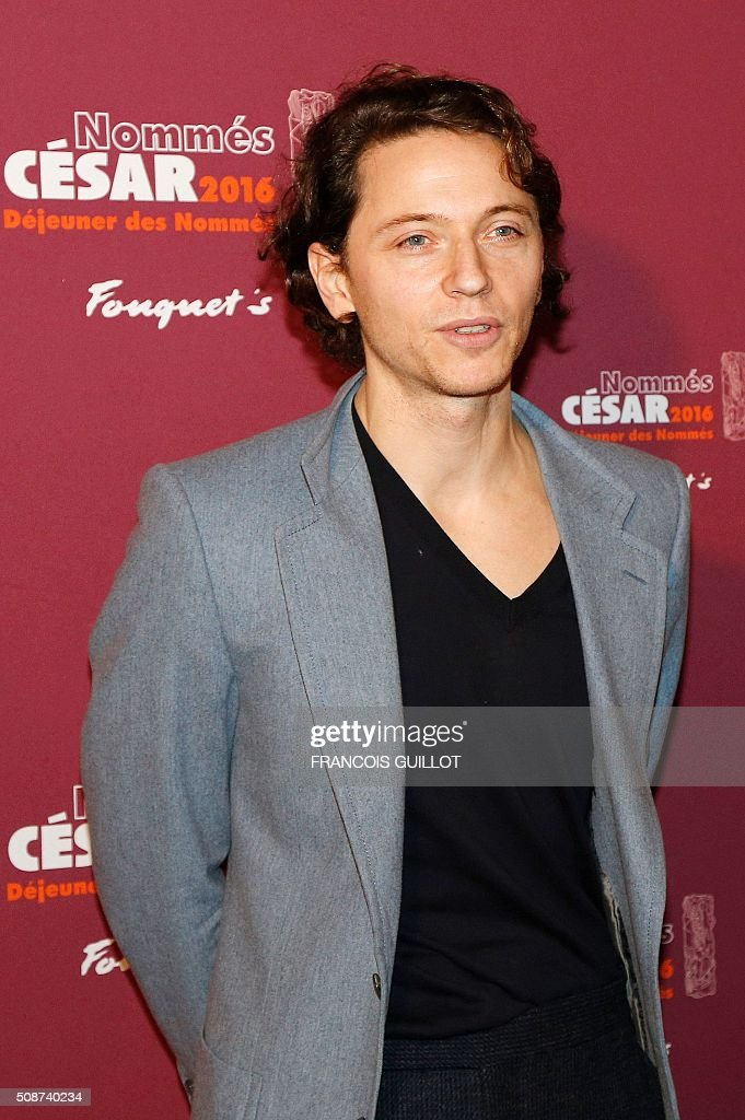 French singer Raphael, nominated for Best Original Music, poses during the nominations event for the 2016 César film awards, on February 6, 2016 in Paris. The 41st Ceremony for the Cesar film award, considered as the highest film honour in France, will take place on February 26, 2016. / AFP / FRANCOIS GUILLOT