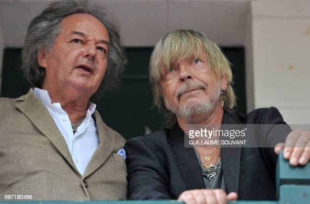 French singer Renaud Séchan and French writer Gonzague Saint Bris look on during the 21th book fair La Foret Des Livres on August 28 2016 in...