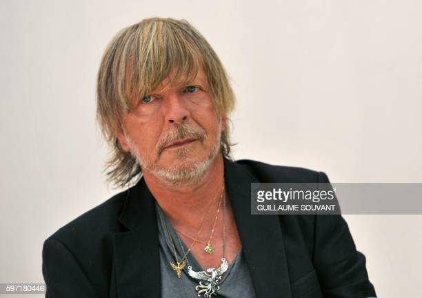 French singer Renaud Séchan looks on during the 21th book fair La Foret Des Livres on August 28 2016 in ChanceauxprèsLoches central France / AFP /...
