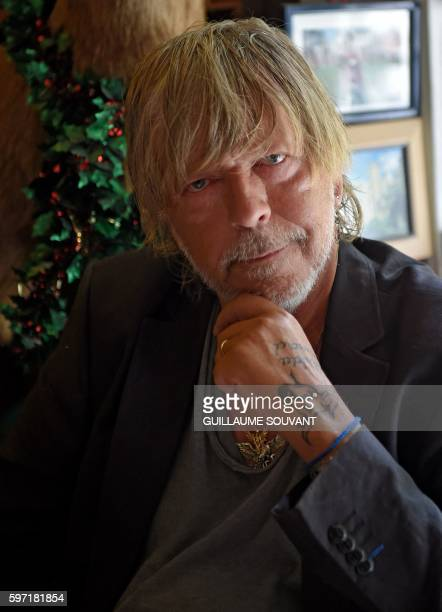 French singer Renaud Séchan poses during the 21th book fair La Foret Des Livres on August 28 2016 in ChanceauxprèsLoches central France / AFP /...