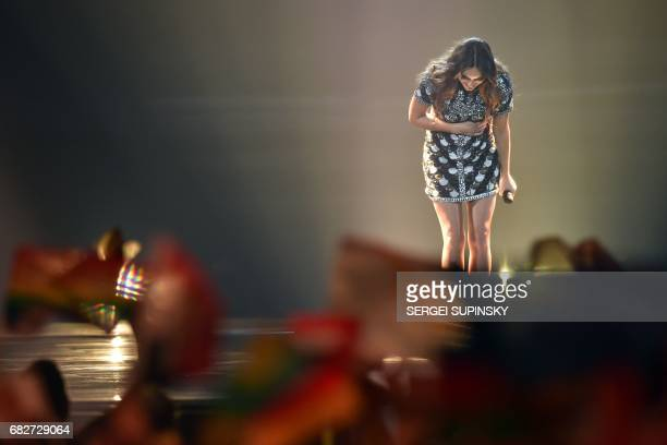 French singer representing France with the song 'Requiem' Alexandra Maquet aka Alma salutes the audience after performing on stage during the final...