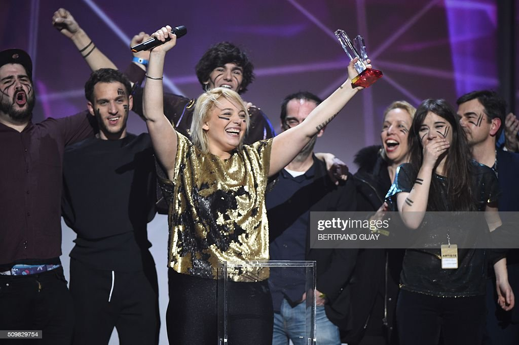 French singer Santa of French pop rock band music 'Hyphen Hyphen' celebrates as she received the best newcomer live show award during the 31st Victoires de la Musique, the annual French music awards ceremony, on February 12, 2016 at the Zenith concert hall in Paris. AFP PHOTO / BERTRAND GUAY / AFP / BERTRAND GUAY