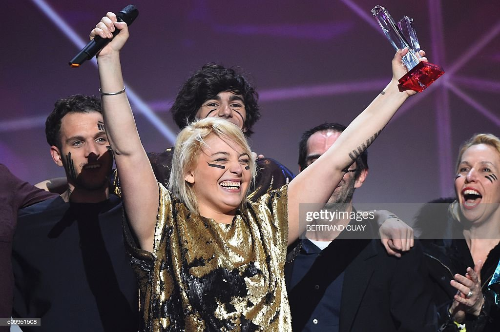 French singer Santa of French pop rock band music 'Hyphen Hyphen' celebrates as she received the best newcomer live show award during the 31st Victoires de la Musique, the annual French music awards ceremony, on February 12, 2016 at the Zenith concert hall in Paris. / AFP / BERTRAND GUAY