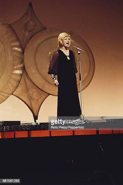 French singer Severine performs the song 'Un banc un arbre une rue' on stage for Monaco in the 1971 Eurovision Song Contest at the Gaiety Theatre in...