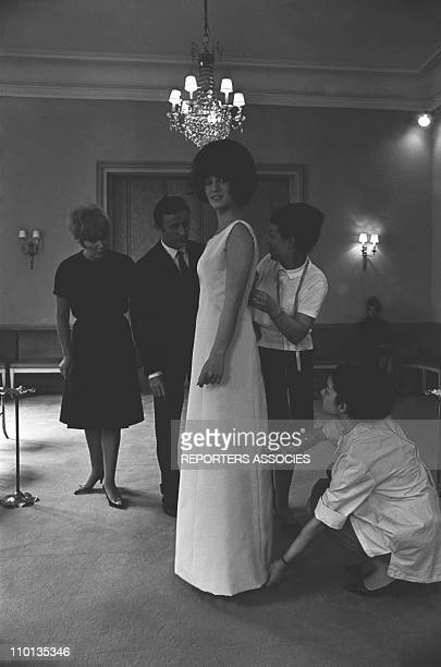 French singer Sheila trying dresses at designer Guy Laroche's home in France on May 07 1965