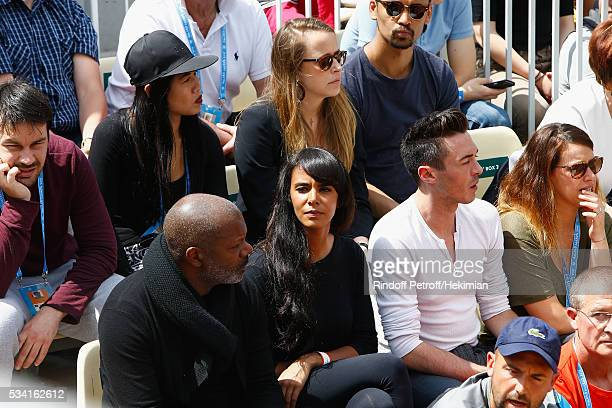 French Singer Shy'm is looking at her boyfriend French tennis player Benoit Paire between two serve during the French Tennis Open at Roland Garros on...