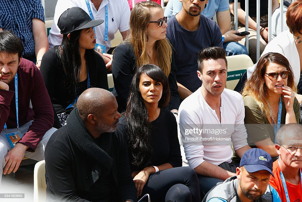 French Singer <a gi-track='captionPersonalityLinkClicked' href=/galleries/search?phrase=Shy%27m&family=editorial&specificpeople=4115080 ng-click='$event.stopPropagation()'>Shy'm</a> (2nd from L) is looking at her boyfriend, French tennis player Benoit Paire, between two serve during the French Tennis Open at Roland Garros on May 25, 2016 in Paris, France.