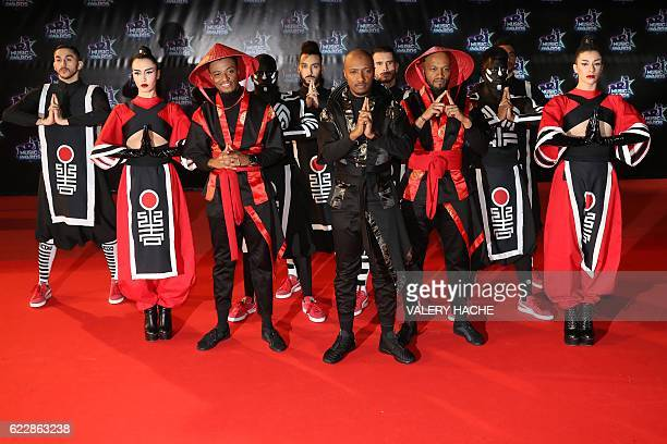 French singer Soprano with dancers poses upon arrival at the Palais des Festivals to attend the 18th Annual NRJ Music Awards on November 12 2016 in...