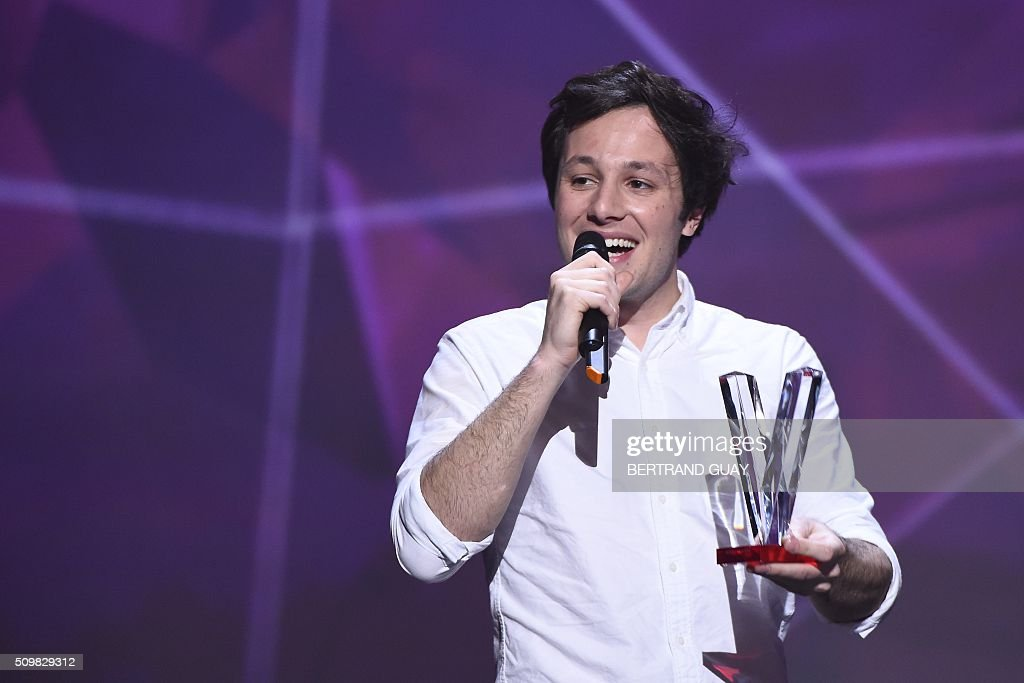 French singer Vianney Bureau aka Vianney speaks as he received the male artist award during the 31st Victoires de la Musique, the annual French music awards ceremony, on February 12, 2016 at the Zenith concert hall in Paris. AFP PHOTO / BERTRAND GUAY / AFP / BERTRAND GUAY