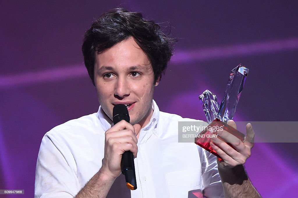 French singer Vianney Bureau aka Vianney speaks as he received the male artist award during the 31st Victoires de la Musique, the annual French music awards ceremony, on February 12, 2016 at the Zenith concert hall in Paris. / AFP / BERTRAND GUAY