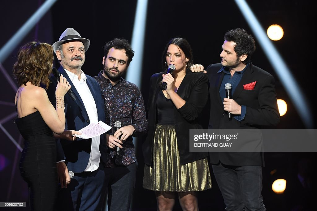 French singers and musicians (from L) Louis, Joseph, Anna and Matthieu Chedid speak with French TV host and Master of Ceremony Virginie Guilhaume (L) during the 31st Victoires de la Musique, the annual French music awards ceremony, on February 12, 2016 at the Zenith concert hall in Paris. AFP PHOTO / BERTRAND GUAY / AFP / BERTRAND GUAY