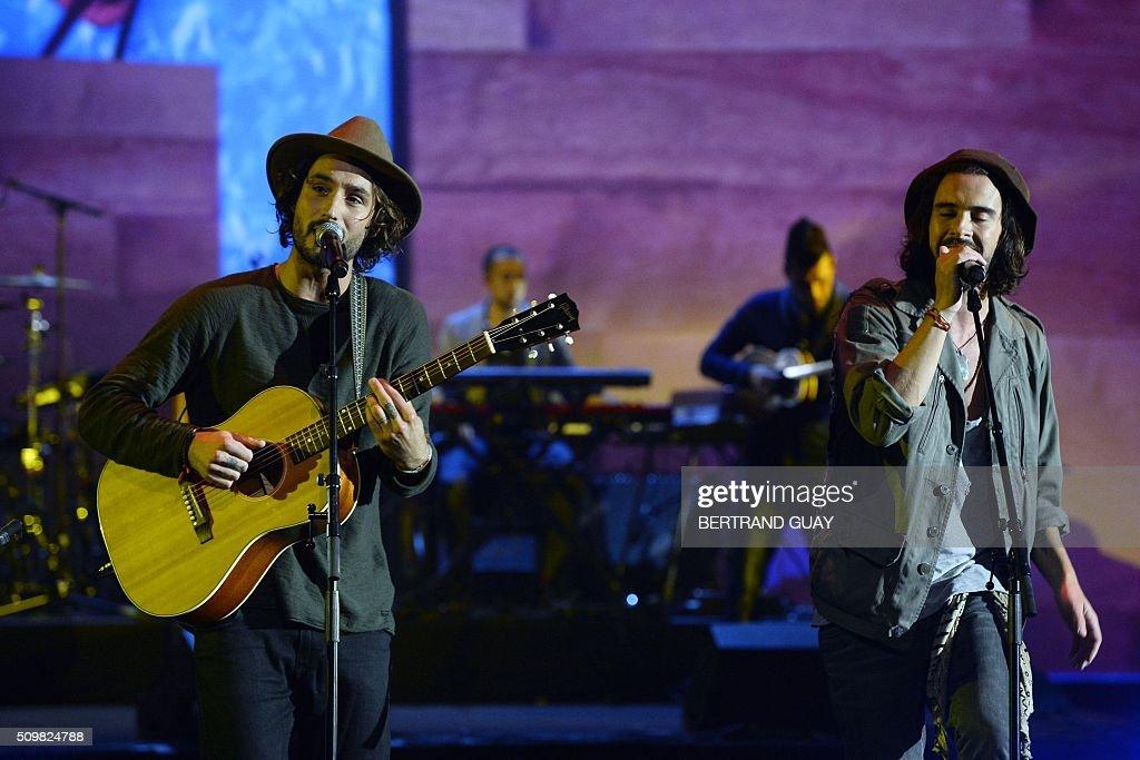 French singers and musicians of the band 'Frero Delavega' Jérémy Frérot (L) and Florian Delavega (R) perform on stage during the 31st Victoires de la Musique, the annual French music awards ceremony, on February 12, 2016 at the Zenith concert hall in Paris. AFP PHOTO / BERTRAND GUAY / AFP / BERTRAND GUAY