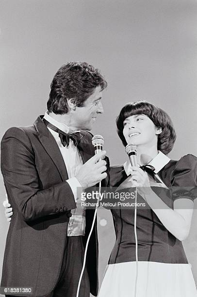 French singers Sacha Distel and Mireille Mathieu performing on the television program Numero 1 Distel is an acclaimed jazz guitarist and Mathieu was...