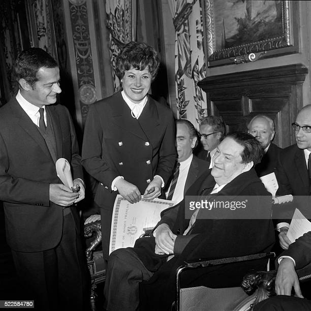 French singers Serge Reggiani and Colette Renard are congratulated by Darius Milhaud after being awarded with the prize 1967 of the French Record...