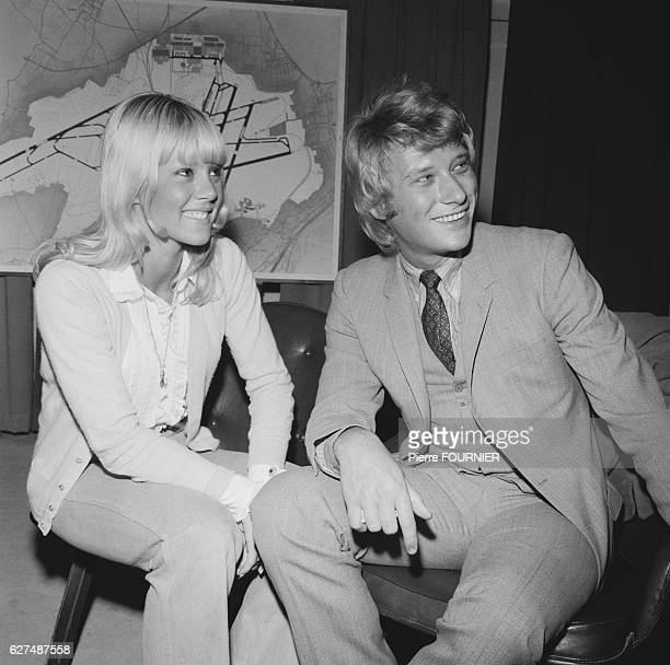 French singers Sylvie Vartan and Johnny Hallyday at the Orly airport near Paris