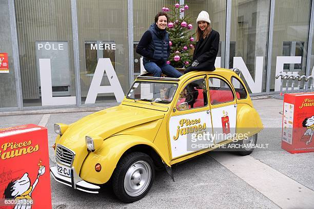 French singers Vianney and Joyce Jonathan pose for pictures during the launch of the 28th edition of the 'Pieces Jaunes' collection operation at the...