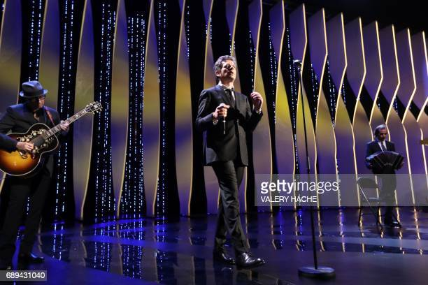 French singer/songwriter Benjamin Biolay performs on May 28 2017 during the closing ceremony of the 70th edition of the Cannes Film Festival in...