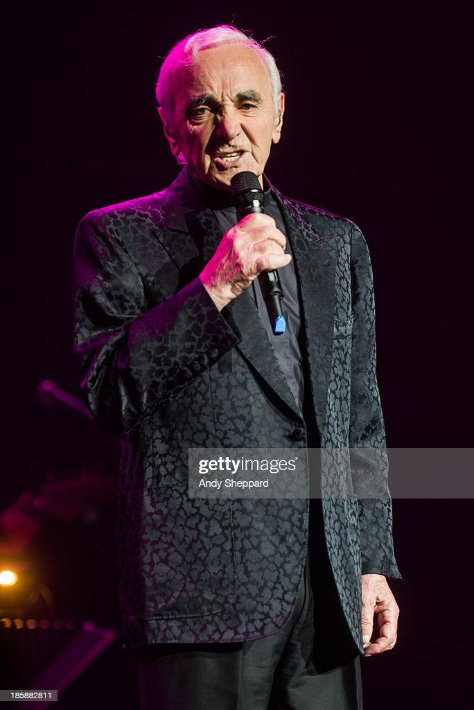 French singer-songwriter <a gi-track='captionPersonalityLinkClicked' href=/galleries/search?phrase=Charles+Aznavour&family=editorial&specificpeople=213405 ng-click='$event.stopPropagation()'>Charles Aznavour</a> performs on stage at Royal Albert Hall on October 25, 2013 in London, England.