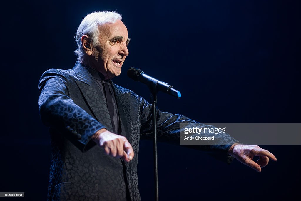 French singer-songwriter Charles Aznavour performs on stage at Royal Albert Hall on October 25, 2013 in London, England.