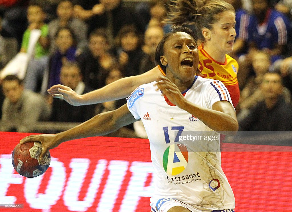 French Siraba Dembele takes a shot during her friendly handball match between France and Spain, on November 30, 2012 at the Palais des victoires sports hall, in Cannes, southeastern France.