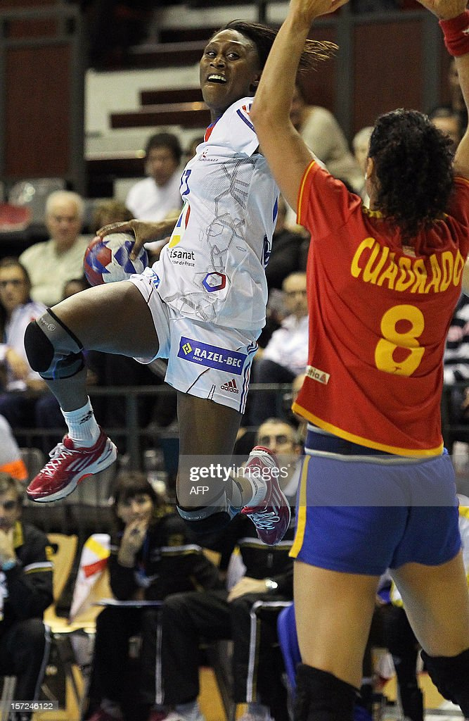 French Sirada Dembele takes a shot during her friendly handball match between France and Spain, on November 30, 2012 at the Palais des victoires sports hall, in Cannes, south-eastern France.