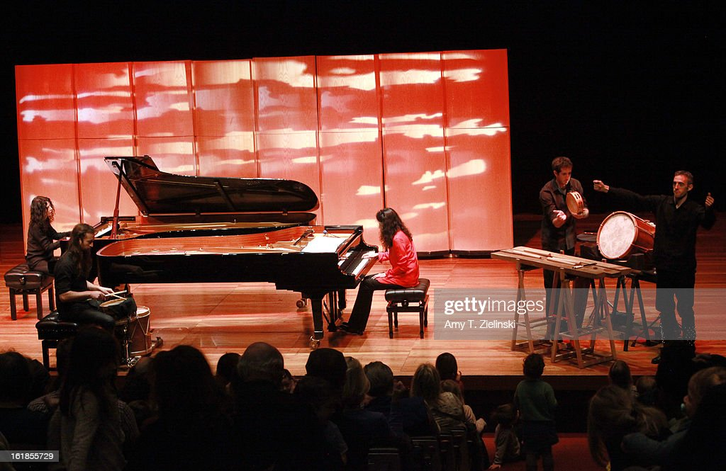 French sisters, concert pianists Katia Labeque (L) and Marielle Labeque (R) perform with the Kalakan Trio on percussion Ravel's 'Bolero' arrangement for duo piano as part of 'Imagine' family concerts programming at the Queen Elizabeth Hall on February 17, 2013 in London, England.