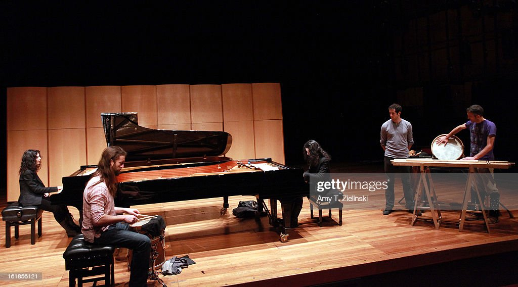 French sisters, concert pianists Katia Labeque (L) and Marielle Labeque (R) rehearse with the Kalakan Trio on percussion Ravel's 'Bolero' arrangement for duo piano for a performance as part of 'Imagine' family concerts and also the 'The Rest Is Noise' programming at the Queen Elizabeth Hall on February 17, 2013 in London, England. Jamixel Bereau (L), Xan Errotabehere (C) and Thierry Biscary (R) form the Kalakan Trio.