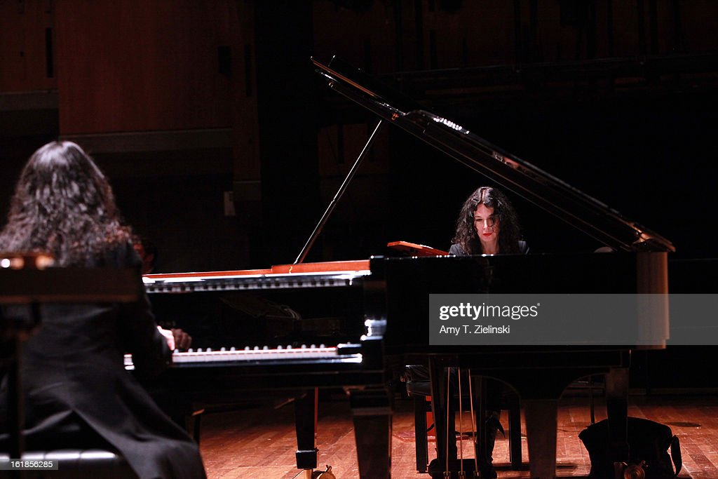 French sisters, concert pianists <a gi-track='captionPersonalityLinkClicked' href=/galleries/search?phrase=Katia+Labeque&family=editorial&specificpeople=5796021 ng-click='$event.stopPropagation()'>Katia Labeque</a> (R) and <a gi-track='captionPersonalityLinkClicked' href=/galleries/search?phrase=Marielle+Labeque&family=editorial&specificpeople=5796023 ng-click='$event.stopPropagation()'>Marielle Labeque</a> (L) rehearse with the Kalakan Trio on percussion Ravel's 'Bolero' arrangement for duo piano for a performance as part of 'Imagine' family concerts and also the 'The Rest Is Noise' programming at the Queen Elizabeth Hall on February 17, 2013 in London, England.