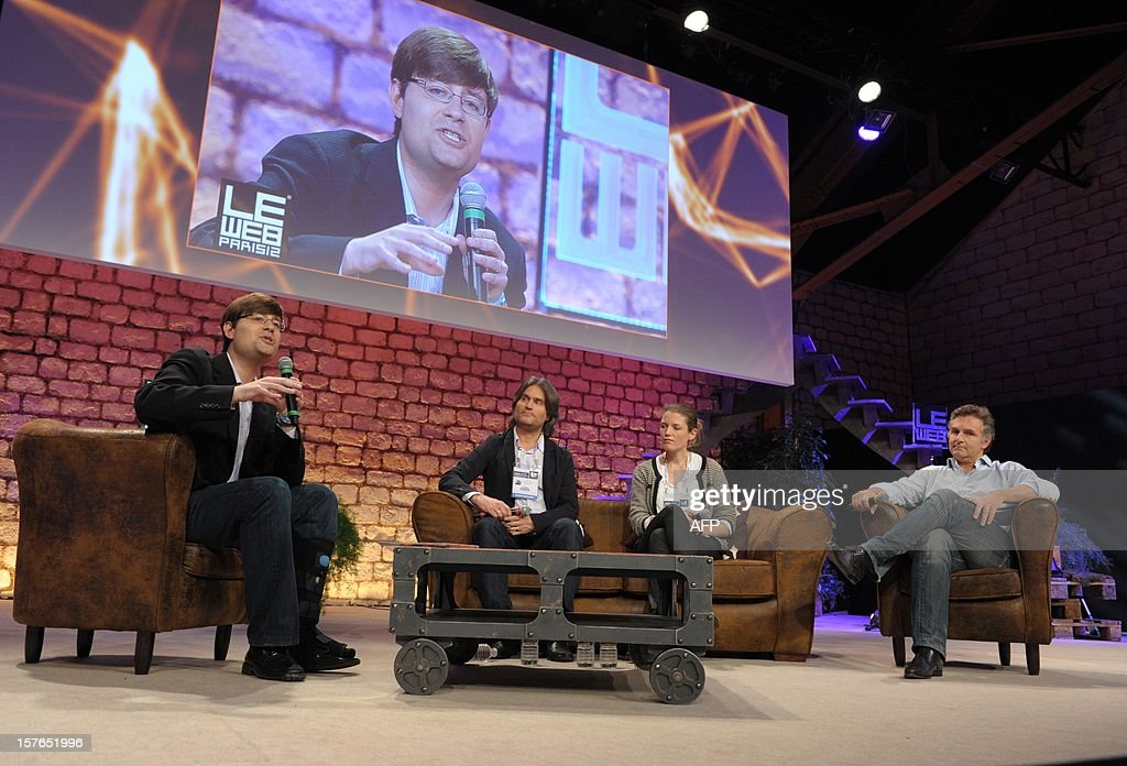 French site for listening to music on demand Deezer CEO Axel Dauchez, Danish Sports community based on free real-time GPS tracking Endomondo co-founder Mette Lykke, British Media engagement company Shazam Chief Technology Officer Jason Titus, listen to Justin Osofsky, Director of Platform Partnerships and Operations at Facebook (on screen) while attending a session at LeWeb Paris 2012 in Saint-Denis, near Paris on December 5, 2012.